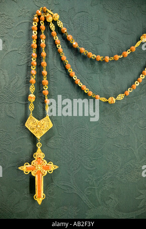 A close up of golden rosary that Pope owned in the Sevilla Cathedral Southern Spain - Stock Photo