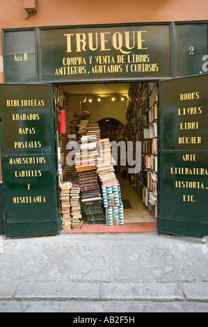Stacks of books in front of bookstore in centro district of Sevilla Spain - Stock Photo