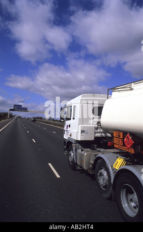tanker lorry showing hazard notification of details of  substance being carried in tanker travelling on the m62 - Stock Photo