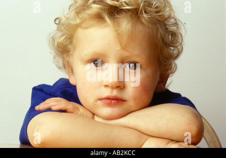 portrait of young boy looking angelic - Stock Photo