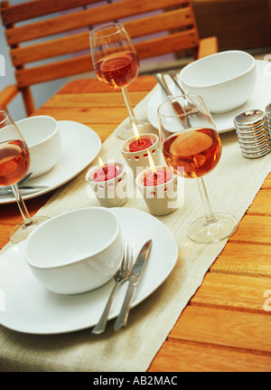 Interior detail a table including wine glasses and candles - Stock Photo
