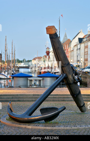 Giant anchor on display at the Nyhavn canal in Copenhagen Denmark. - Stock Photo