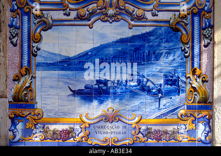 Portugal Azulejos tiles depicting Douro river scene on station wall at Pinhao Minho Region - Stock Photo