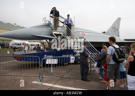 people queuing to sit in a typhoon t1 aircraft at cosford airshow raf cosford shifnal shropshire england uk - Stock Photo