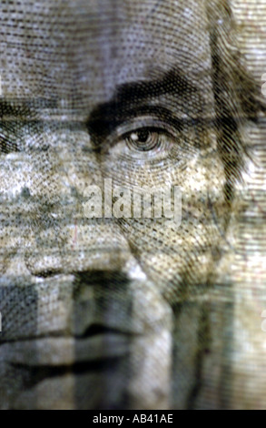 Money US Currency five dollar bill with Abraham Lincoln face - Stock Photo