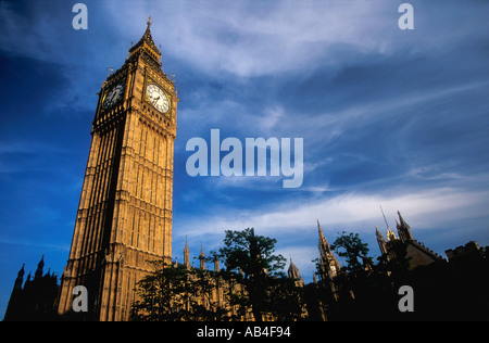 Big Ben clock Houses of Parliament Westminster London in evening summer sunshine England Great Britain United Kingdom UK GB