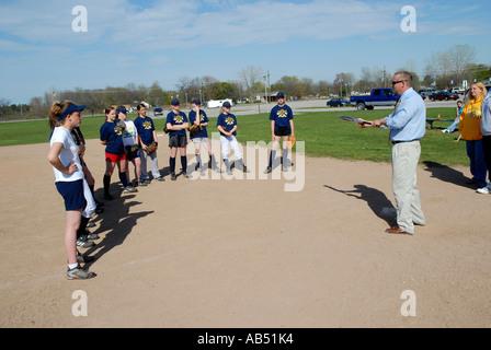 Middle school girl softball player sliding into home base ...