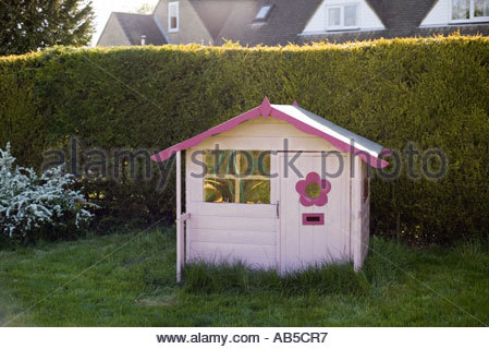 Pink Wendy House for children to play in in a garden CREDIT Geraint Lewis - Stock Photo