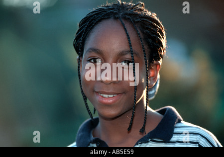 French African origin 12 year old Female Teenager portrait Girl Child Smiling Outside - Stock Photo