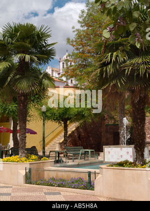 FOUNTAIN in LARGO DO MUNICIPIO with steps towards the gothic 13th century Cathedral Silves Algarve Portugal - Stock Photo