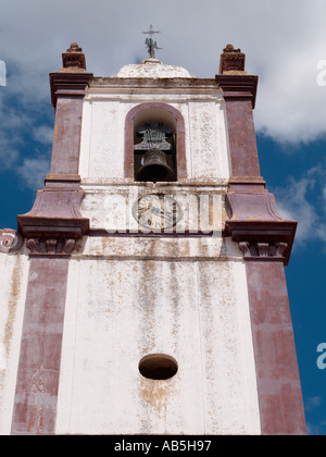 CATHEDRAL BELL TOWER and CLOCK from below in the old Moorish hill town of Silves Algarve Portugal - Stock Photo
