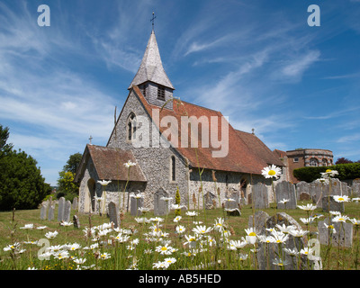Country church of St Margaret with shingled bellcote and Oxeye Daisies. Eartham West Sussex England UK Britain - Stock Photo