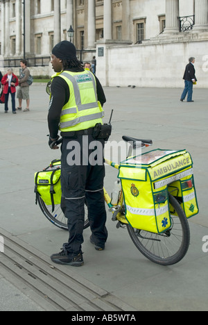 Trafalgar Square push bike paramedic from the London Ambulance Service seen just after attending a 999 incident - Stock Photo