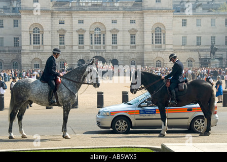 Horseguards parade police on duty during changing the guard ceremony - Stock Photo