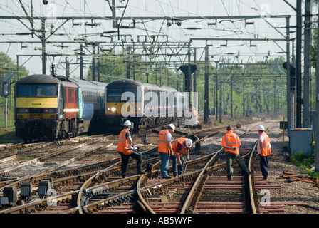 Essex Main Line Railway With Maintenance Workers In High