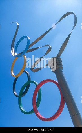 A sculpture of the Olympic Torch with the Olympic rings symbol in Alimos, Athens, Greece. - Stock Photo