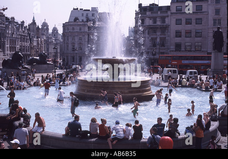 Summer of 2003 swimming in the fountains in Trafalgar Square London - Stock Photo