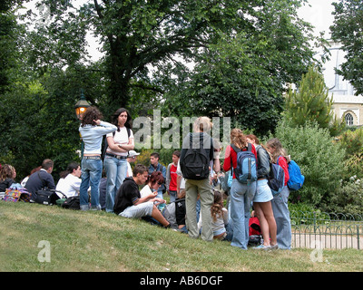 students relaxing in Brighton Pavilion Grounds Brighton East Sussex - Stock Photo