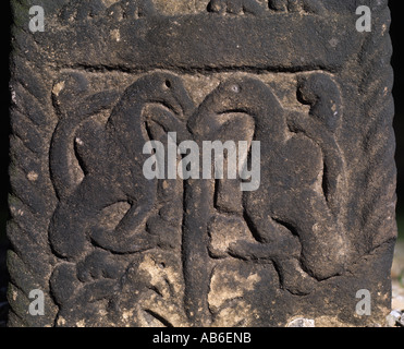 Celtic carving on one of the three Anglo Saxon cross shafts in the churchyard of All Saints church in Ilkley West - Stock Photo