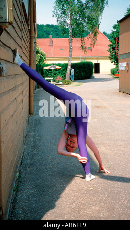 A young girl preparing for a voltige tournament doing gymnastics and warming up - Stock Photo