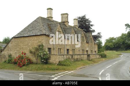 Almshouses at Spelsbury near Chipping Norton Oxfordshire - Stock Photo