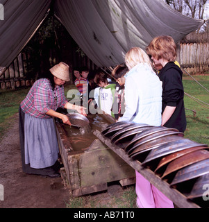 Schoolchildren panning for Gold at Fort Langley in the Fraser Valley of Southwestern British Columbia Canada - Stock Photo