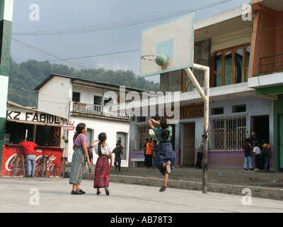 Indigenous children playing basketball in Santiago de Atitlan, Lake Atitlan, Guatemala - Stock Photo
