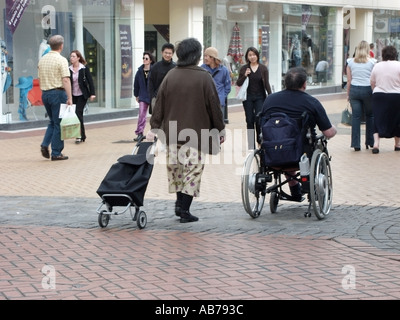 Chelmsford Essex County Town fully paved pedestrianised shopping area people including wheelchair user - Stock Photo