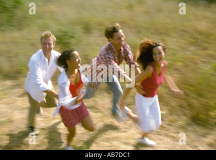Two couples running - Stock Photo