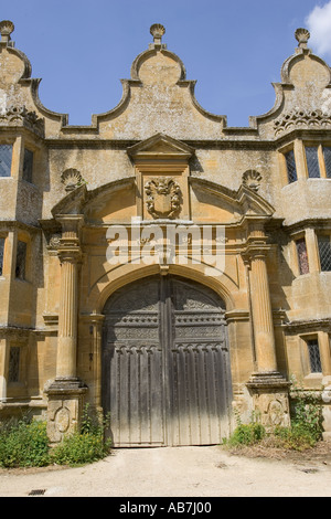 Gatehouse to Stanway Manor House built in Jacobean period architecture 1630 in Guiting yellow stone Stanton Cotswolds - Stock Photo
