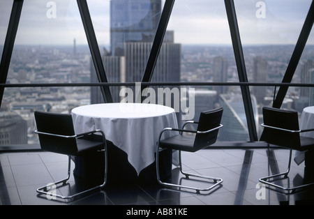 Restaurant at top of The Gherkin (AKA 30 St Mary Axe or Swiss Re Tower) with view to Tower 42 (formerly NatWest - Stock Photo