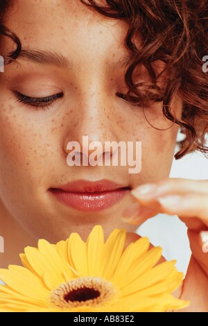 Young woman with flower - Stock Photo