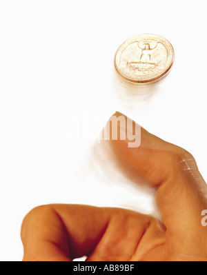 Hand tossing coin - Stock Photo