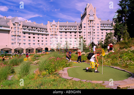 Boys playing Mini Golf at Fairmont Chateau Whistler, Whistler, BC, British Columbia, Canada - Stock Photo