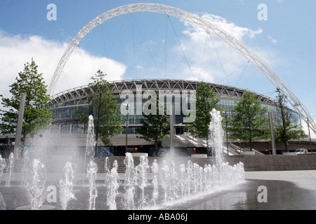 Wembley Stadium with fountain in foreground, North west London, England. As seen from outside Wembley Arena