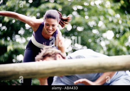 Couple on obstacle course - Stock Photo