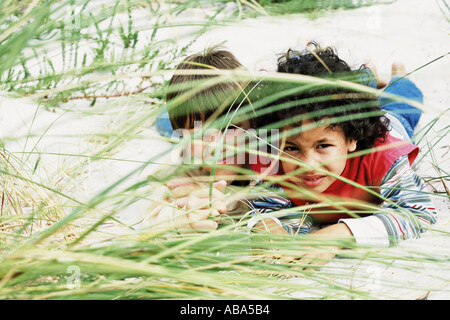 Boys playing hide-and-seek - Stock Photo