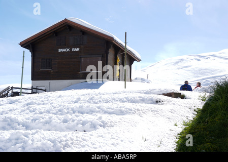 Snack bar in Swiss Alps closed in early summer. - Stock Photo
