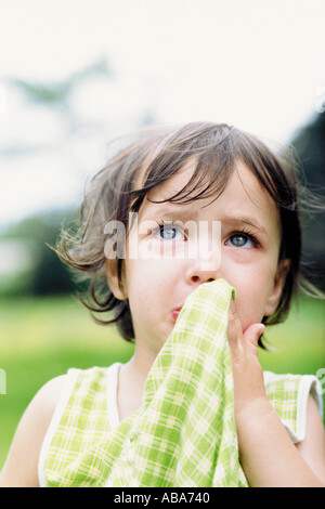 Portrait of a little girl crying - Stock Photo