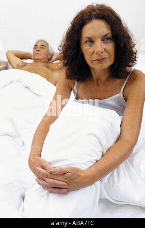 Senior couple in bed - Stock Photo
