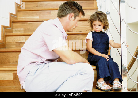 Father telling off naughty daughter - Stock Photo