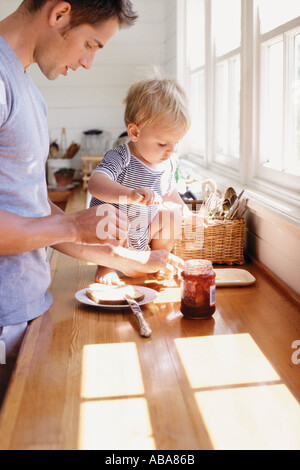 Father and child having breakfast - Stock Photo