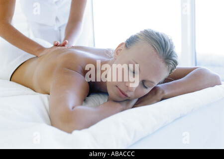 Woman receiving back massage - Stock Photo