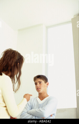 Mother telling off son - Stock Photo