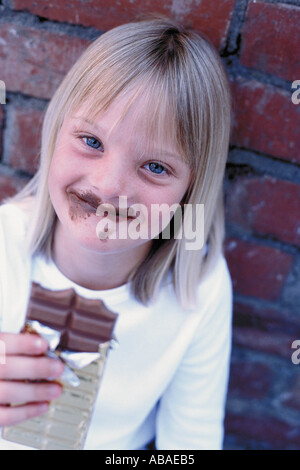 Girl eating chocolate - Stock Photo