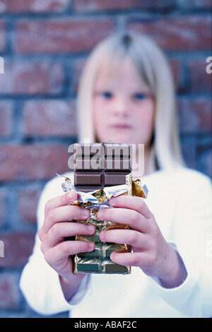 Girl offering chocolate - Stock Photo