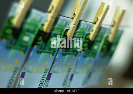 Money on clothes line - Stock Photo
