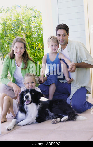 Family with a collie dog - Stock Photo