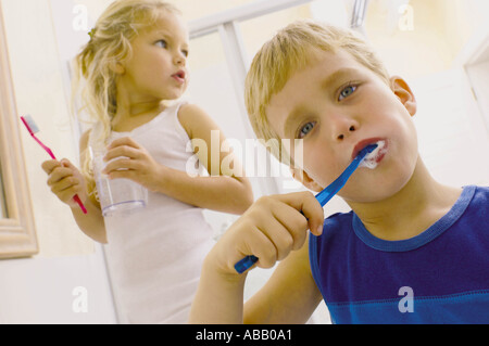 Kids brushing teeth - Stock Photo