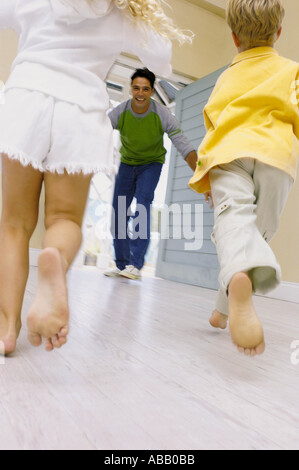 Kids running towards father - Stock Photo